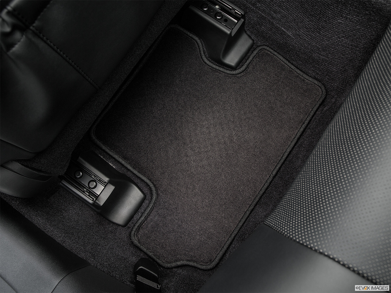 2015 Lexus IS C IS250 RWD Rear driver's side floor mat. Mid-seat level from outside looking in.