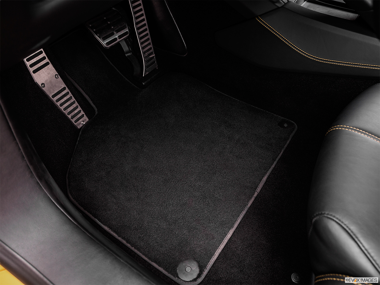 2015 Lamborghini Huracan LP 610-4 Driver's floor mat and pedals. Mid-seat level from outside looking in.