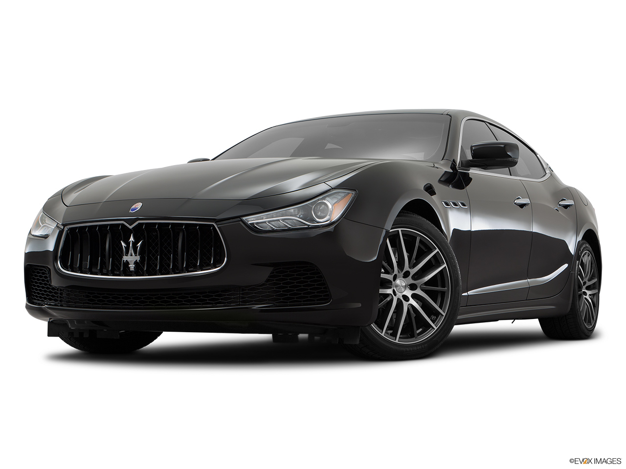 2015 Maserati Ghibli Base Front angle view, low wide perspective.
