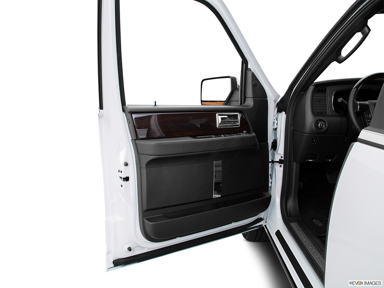 2016 Lincoln Navigator Reserve Inside of driver's side open door, window open.