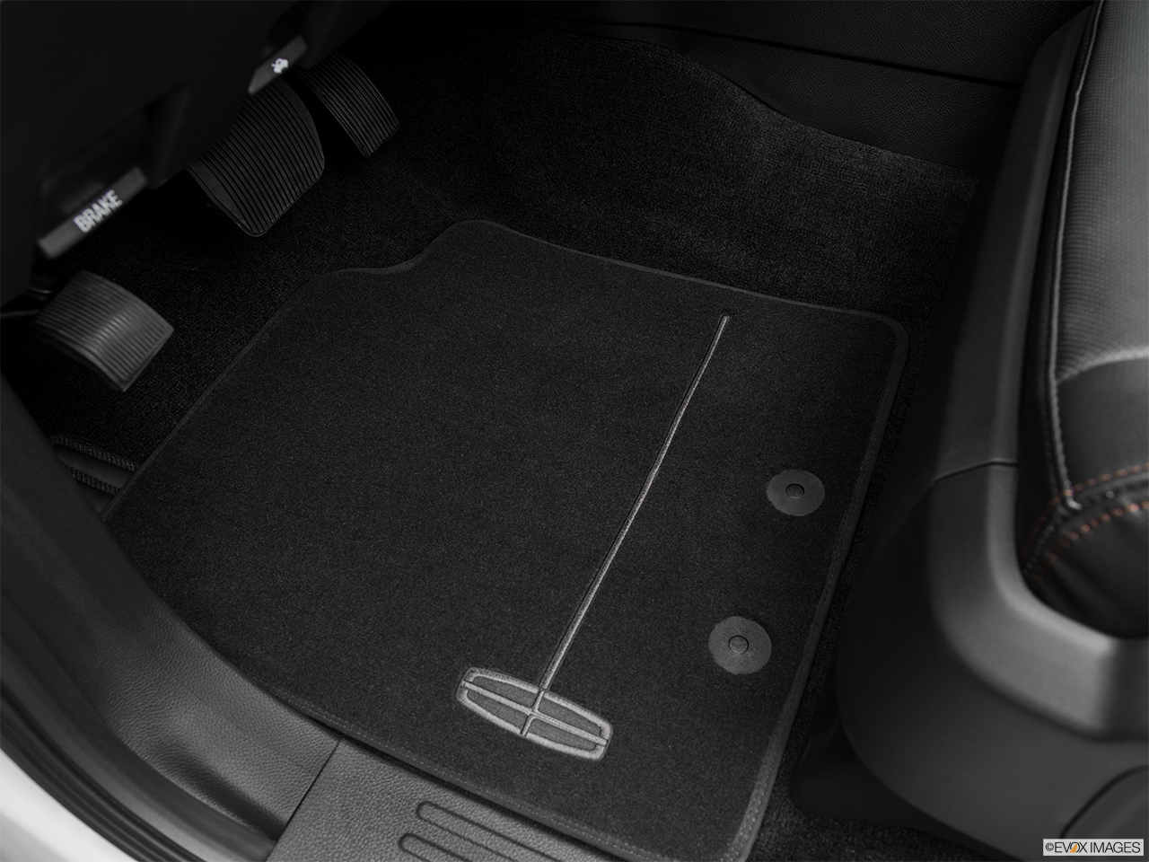 2016 Lincoln Navigator Reserve Driver's floor mat and pedals. Mid-seat level from outside looking in.