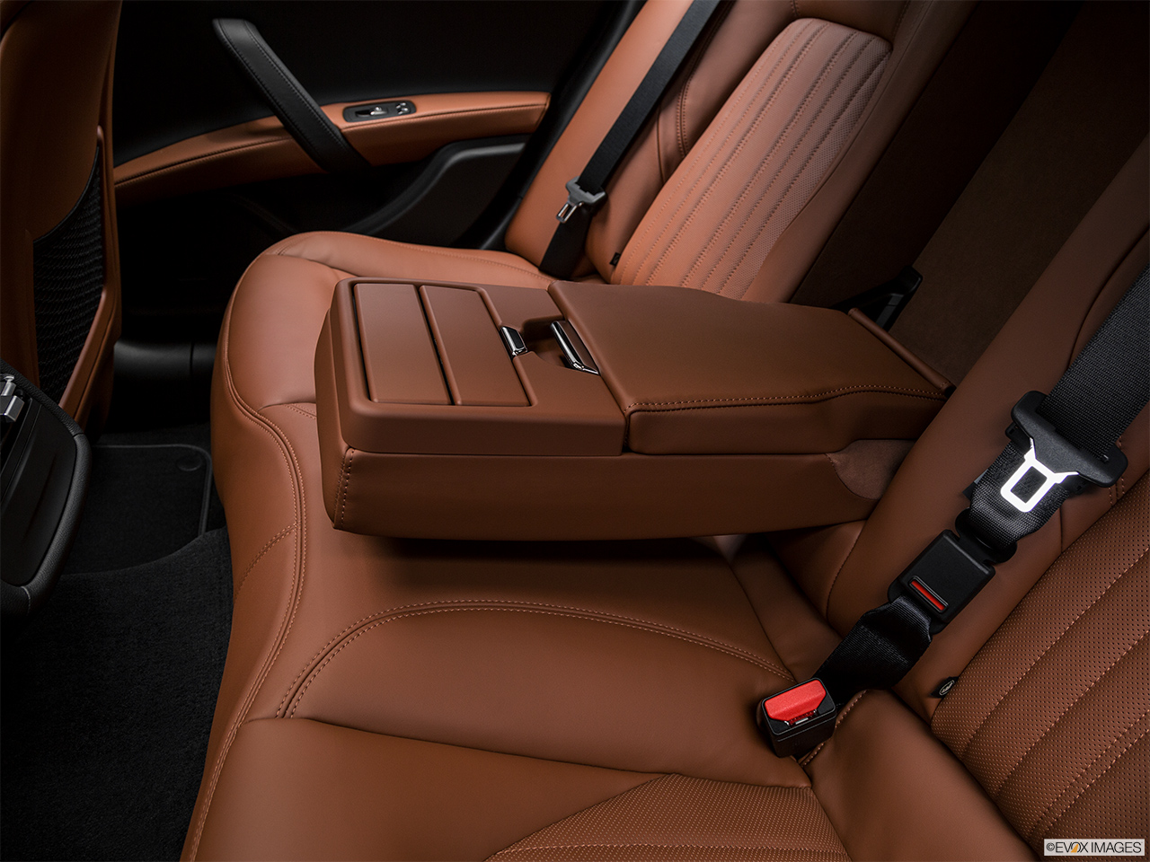 2018 Maserati Ghibli  S Granlusso Rear center console with closed lid from driver's side looking down.