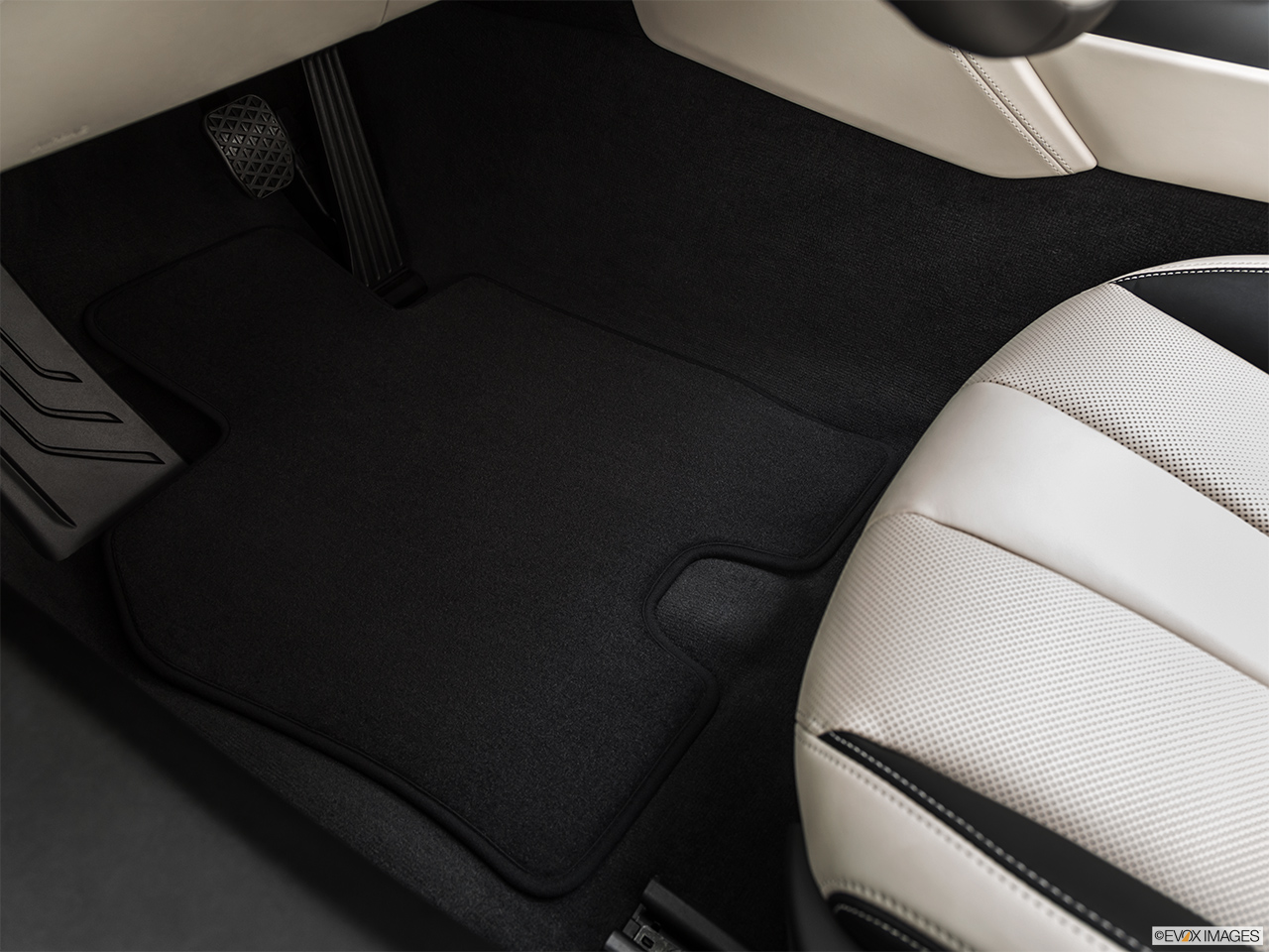 2019 BMW i8 Roadster Standard World Driver's floor mat and pedals. Mid-seat level from outside looking in.