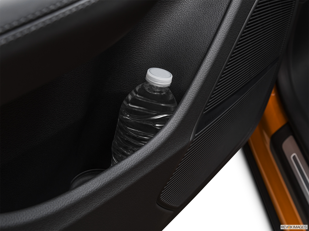 2019 Audi Q8 Prestige 3.0 TFSI Second row side cup holder with coffee prop, or second row door cup holder with water bottle.