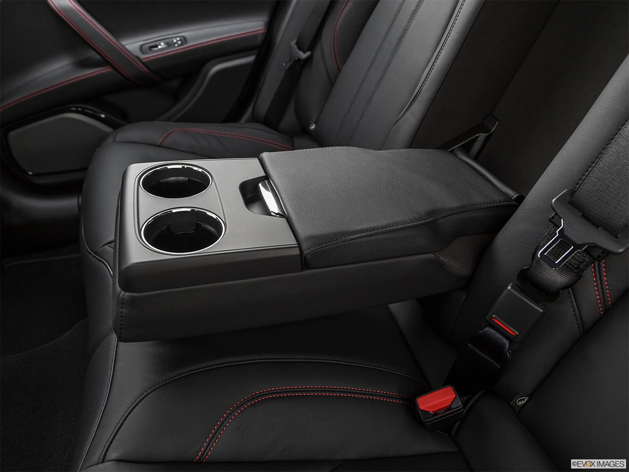 2019 Maserati Ghibli S Gransport Rear center console with closed lid from driver's side looking down.