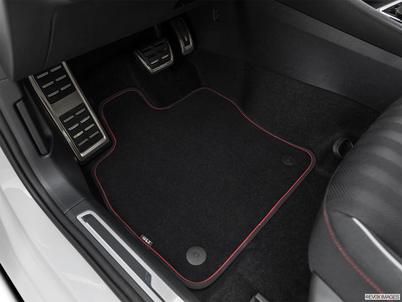 2019 Volkswagen Jetta GLI S Driver's floor mat and pedals. Mid-seat level from outside looking in.