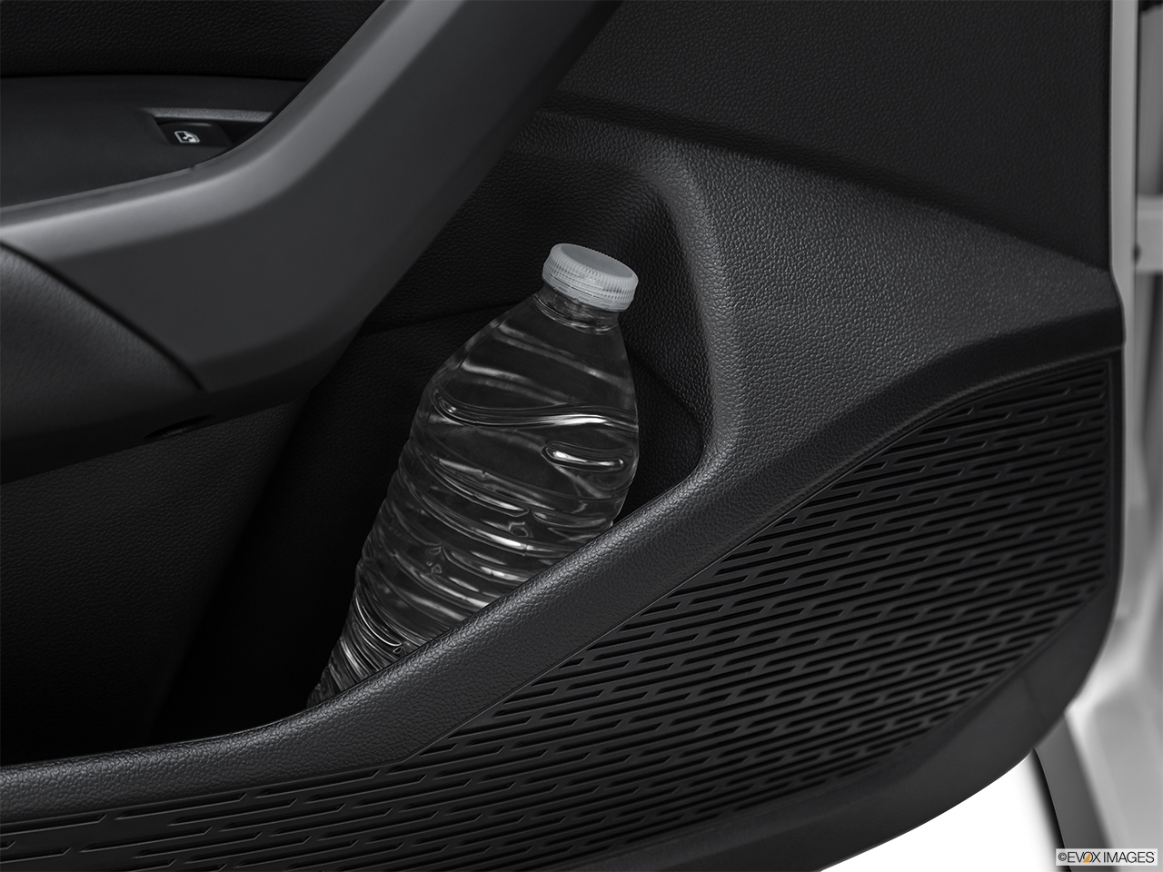 2019 Volkswagen Jetta GLI S Second row side cup holder with coffee prop, or second row door cup holder with water bottle.