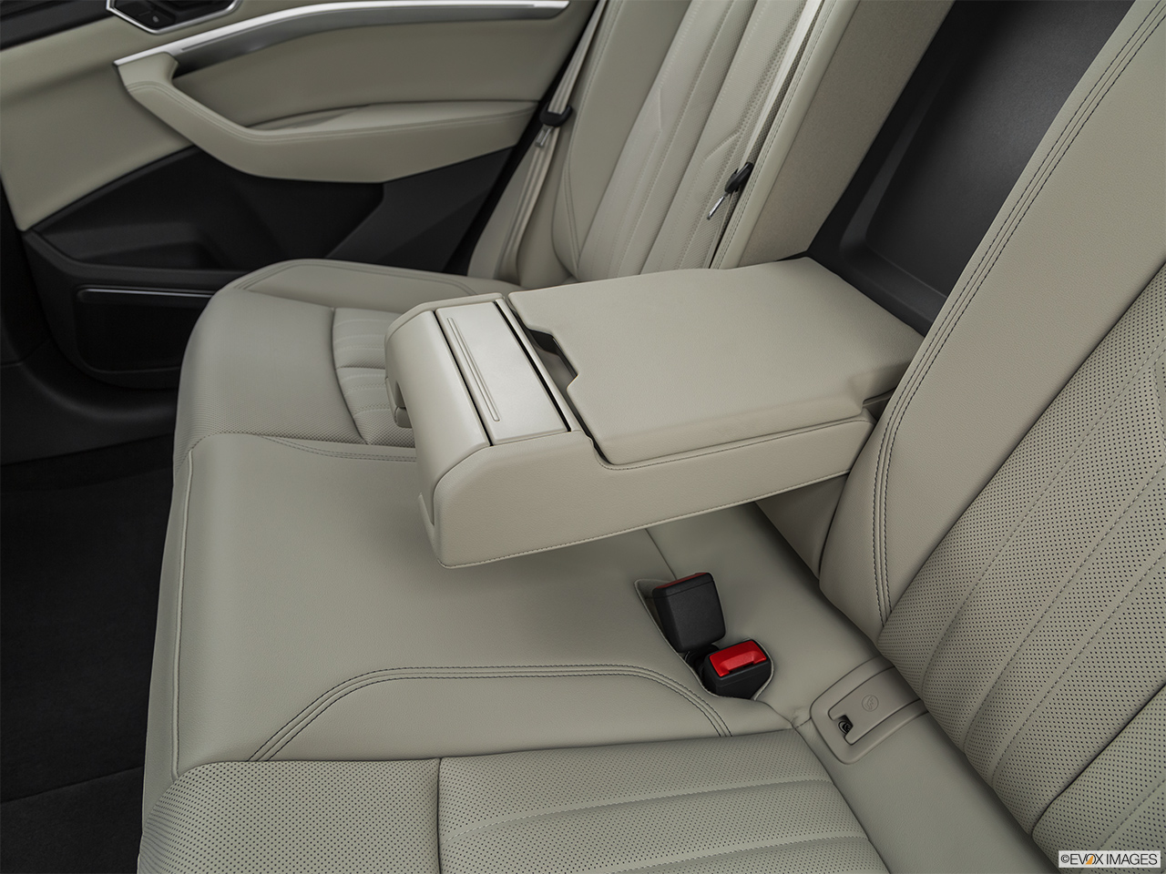 2019 Audi e-tron Premium Plus Rear center console with closed lid from driver's side looking down.