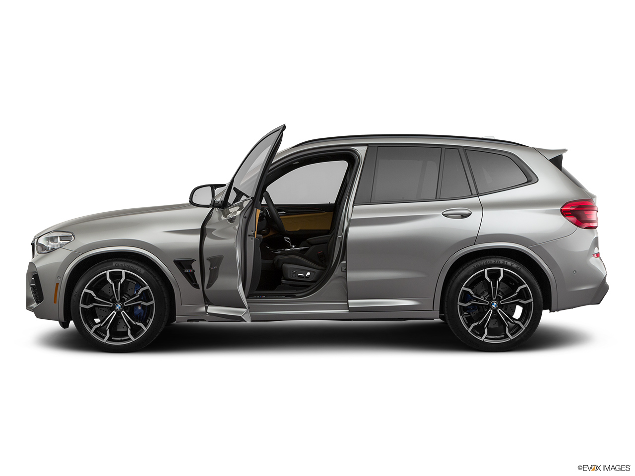 2020 BMW X3 M Competition Driver's side profile with drivers side door open.