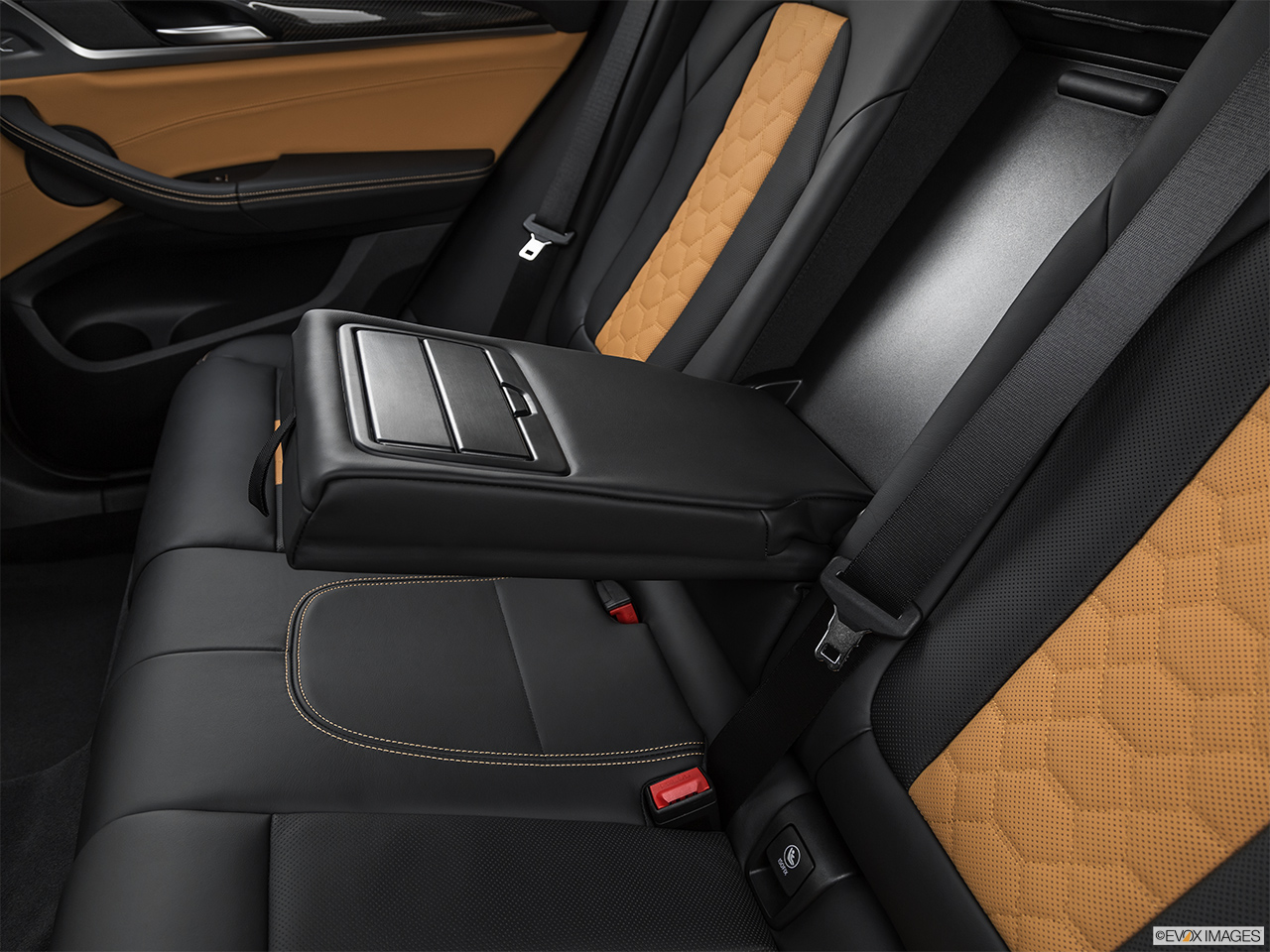 2020 BMW X3 M Competition Rear center console with closed lid from driver's side looking down.