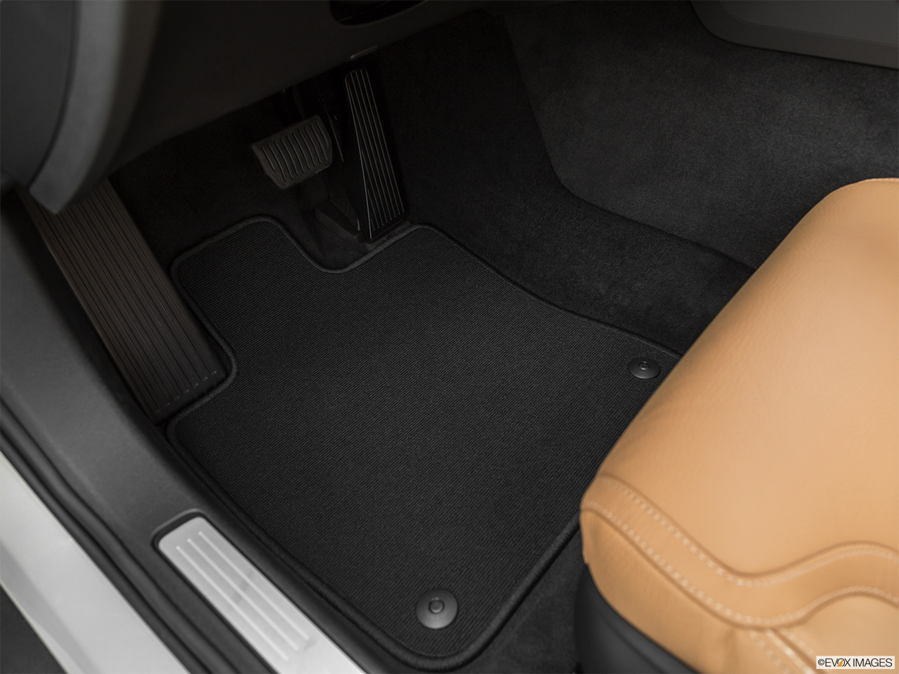 2020 Volvo V60 Cross Country T5 AWD Driver's floor mat and pedals. Mid-seat level from outside looking in.
