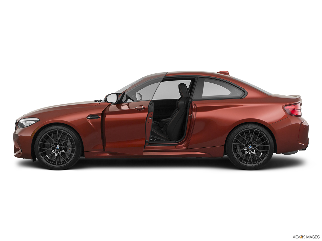 2020 BMW M2 Competition Driver's side profile with drivers side door open.