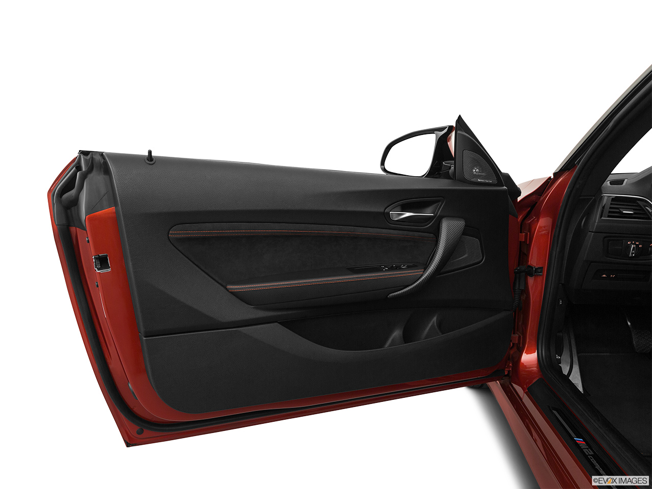 2020 BMW M2 Competition Inside of driver's side open door, window open.