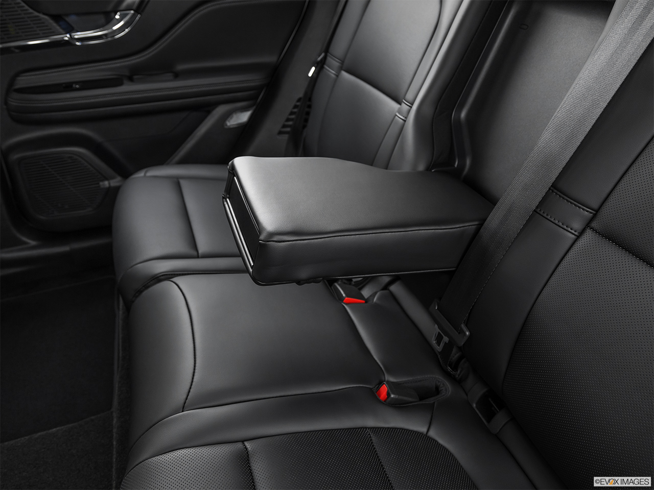 2020 Lincoln Corsair Standard Rear center console with closed lid from driver's side looking down.