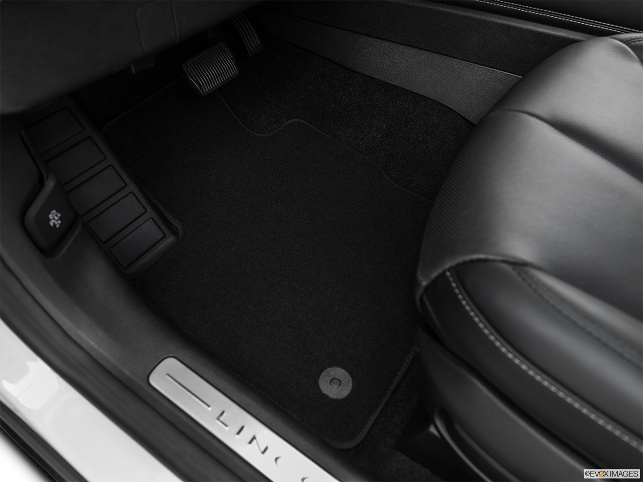 2020 Lincoln Corsair Standard Driver's floor mat and pedals. Mid-seat level from outside looking in.