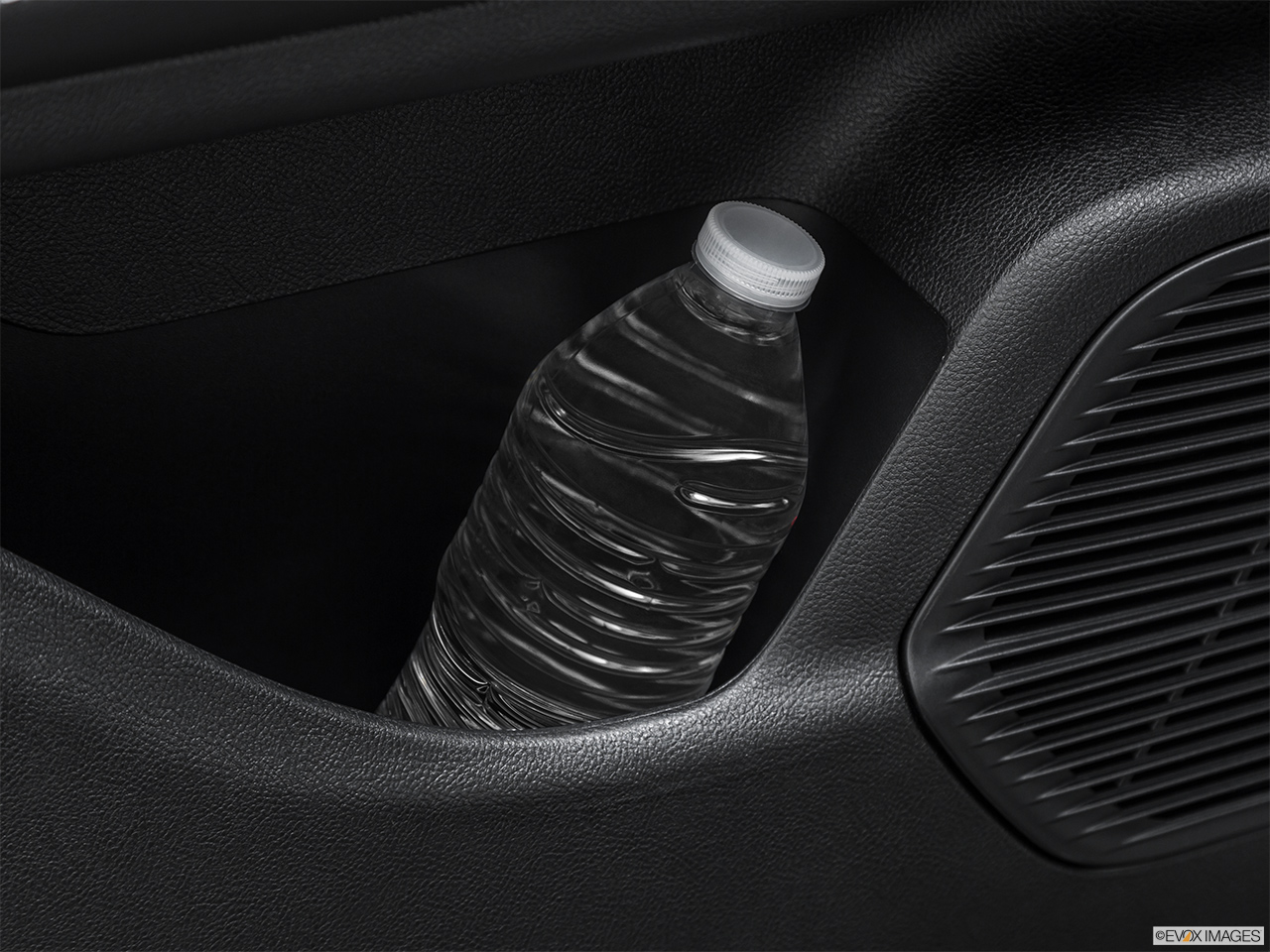 2020 Lincoln Corsair Standard Second row side cup holder with coffee prop, or second row door cup holder with water bottle.