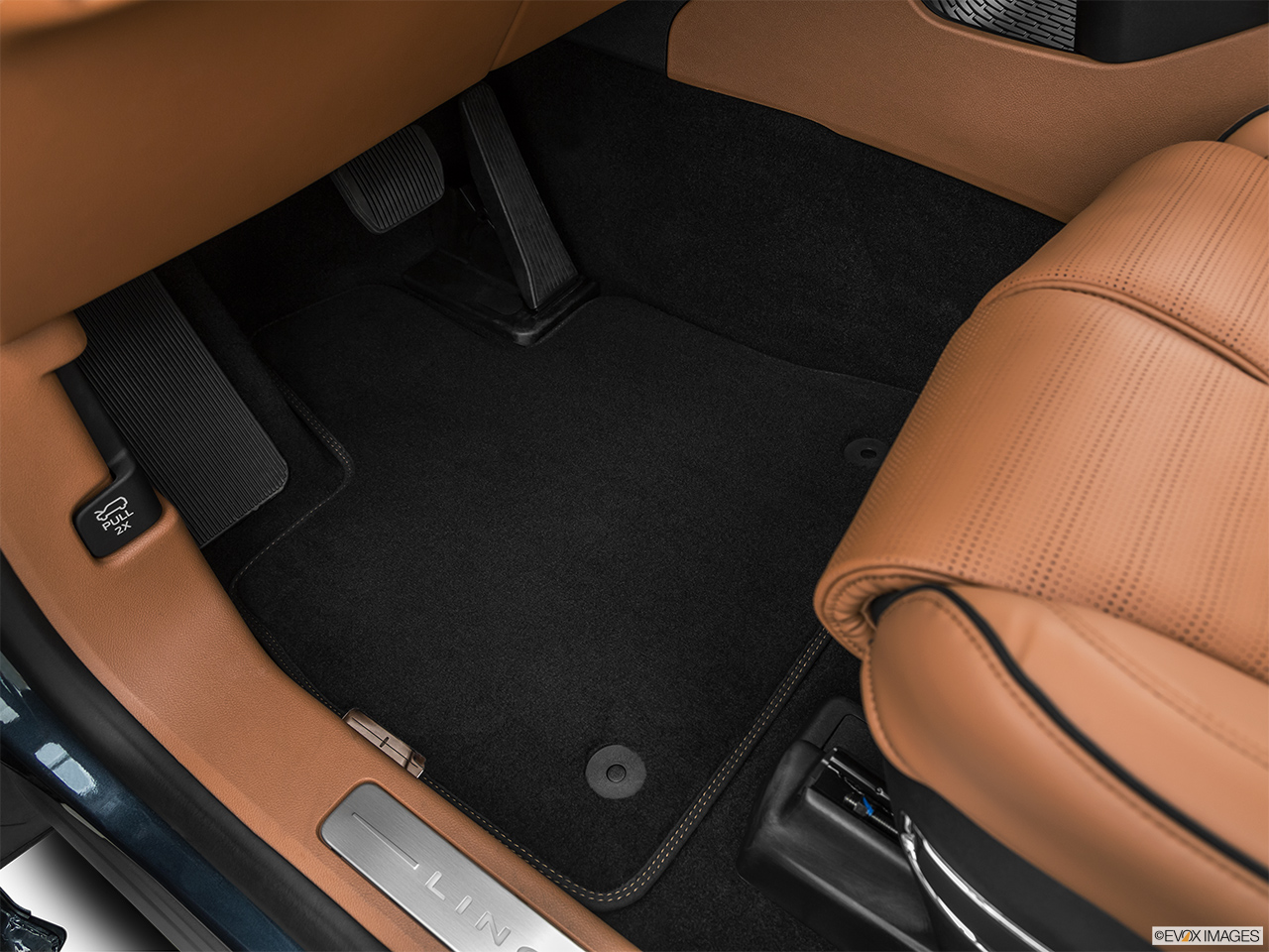 2020 Lincoln Aviator Black Label Driver's floor mat and pedals. Mid-seat level from outside looking in.