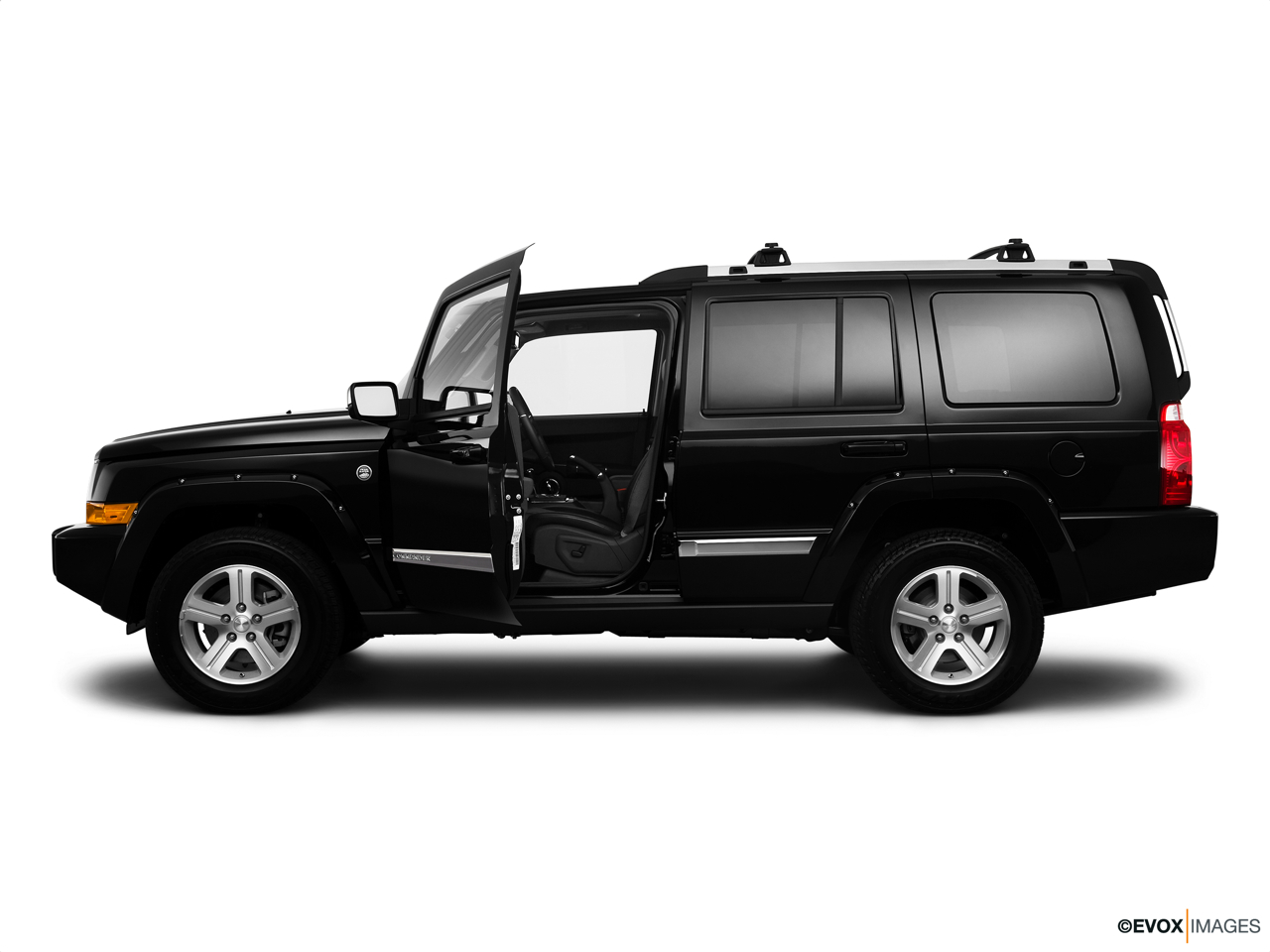 2010 Jeep Commander Limited Driver's side profile with drivers side door open.