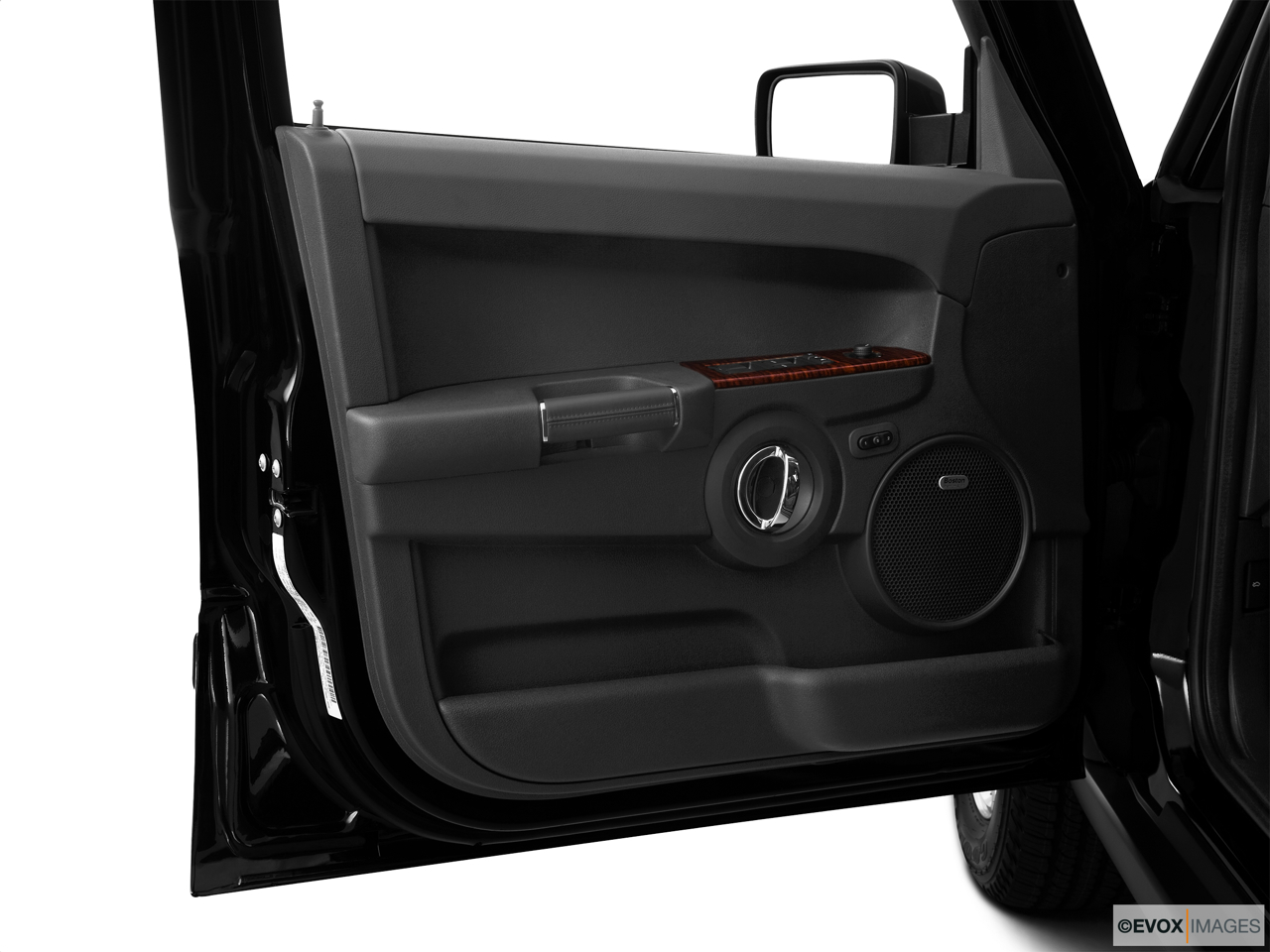 2010 Jeep Commander Limited Inside of driver's side open door, window open.