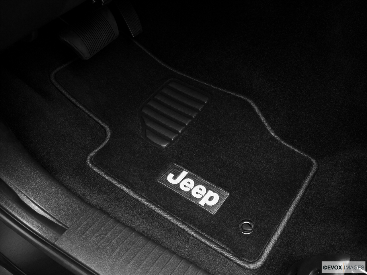 2010 Jeep Commander Limited Driver's floor mat and pedals. Mid-seat level from outside looking in.