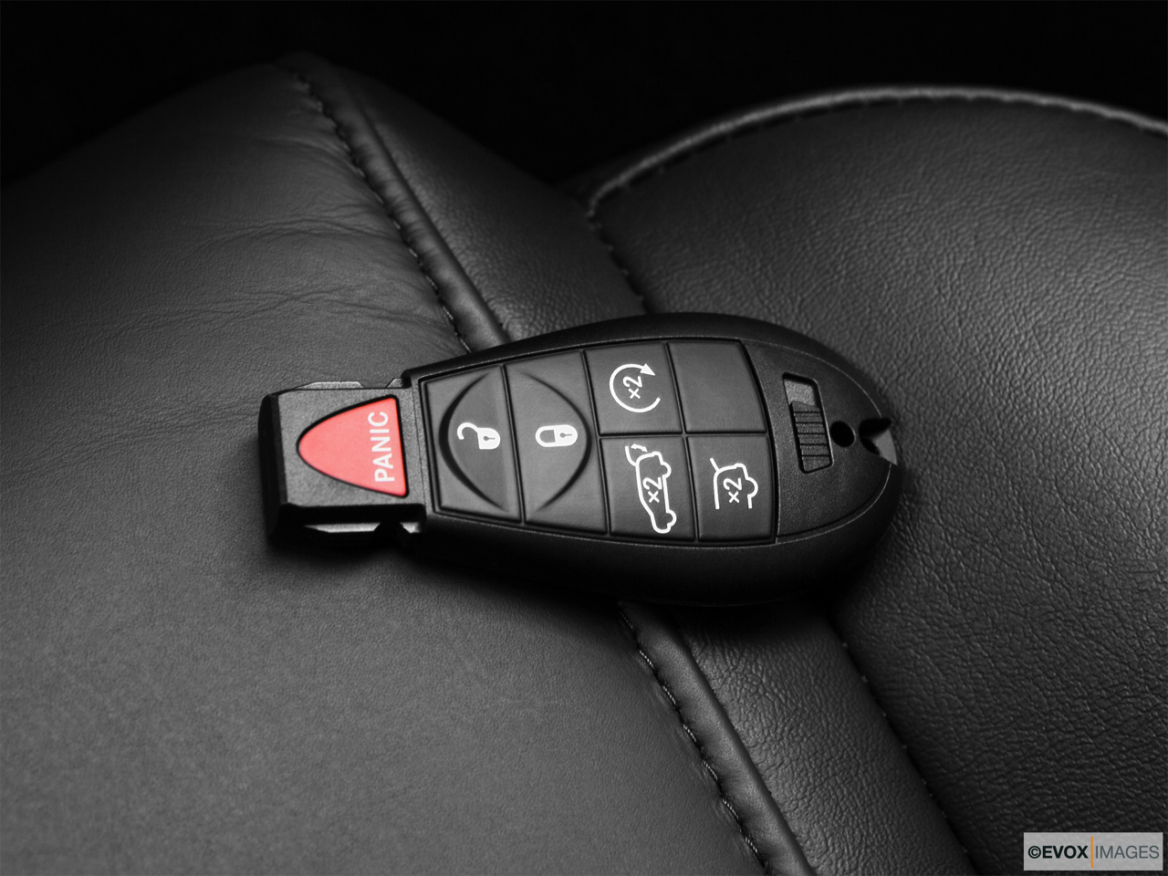 2010 Jeep Commander Limited Key fob on driver's seat.