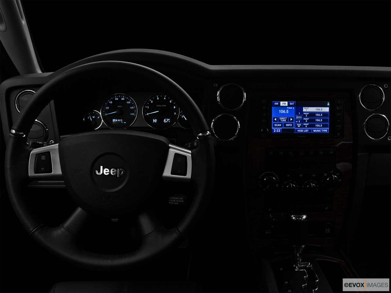"2010 Jeep Commander Limited Centered wide dash shot - ""night"" shot."