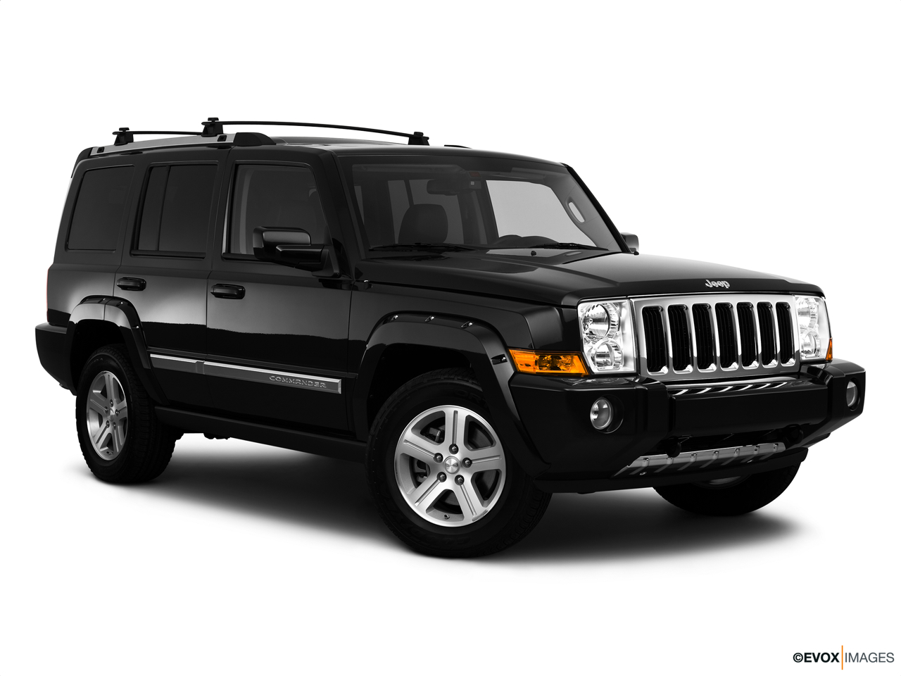 2010 Jeep Commander Limited Front passenger 3/4 w/ wheels turned.