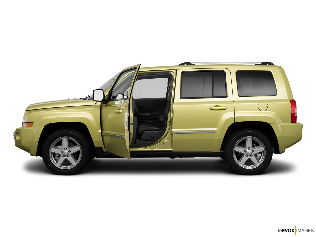 2010 Jeep Patriot Limited Driver's side profile with drivers side door open.