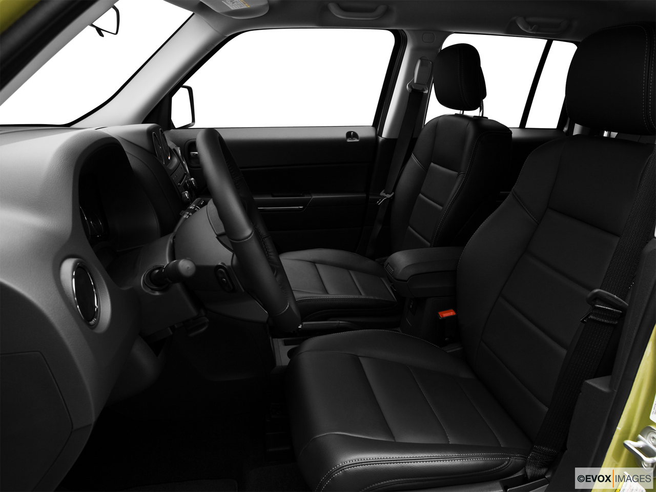 2010 Jeep Patriot Limited Front seats from Drivers Side.
