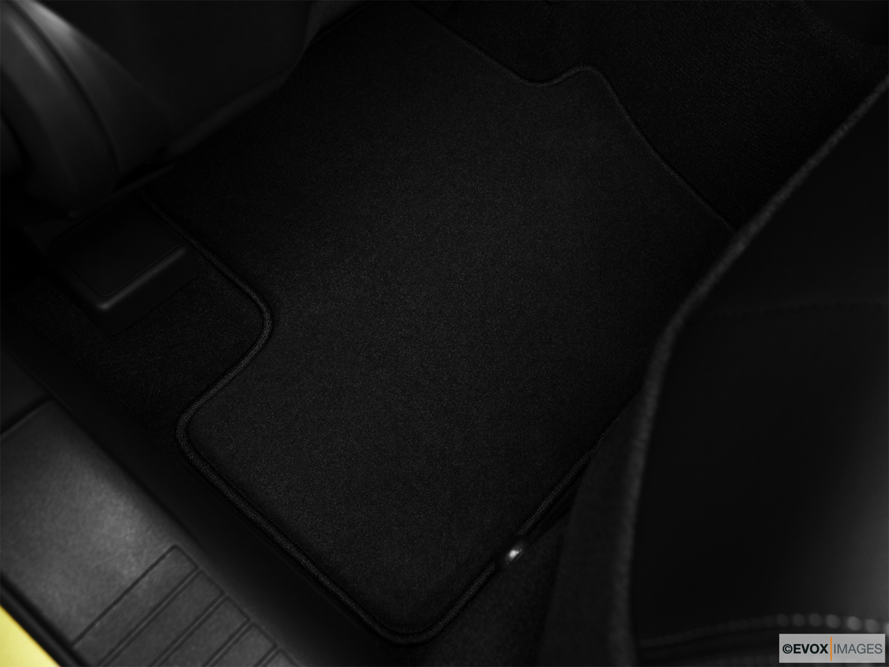 2010 Jeep Patriot Limited Rear driver's side floor mat. Mid-seat level from outside looking in.