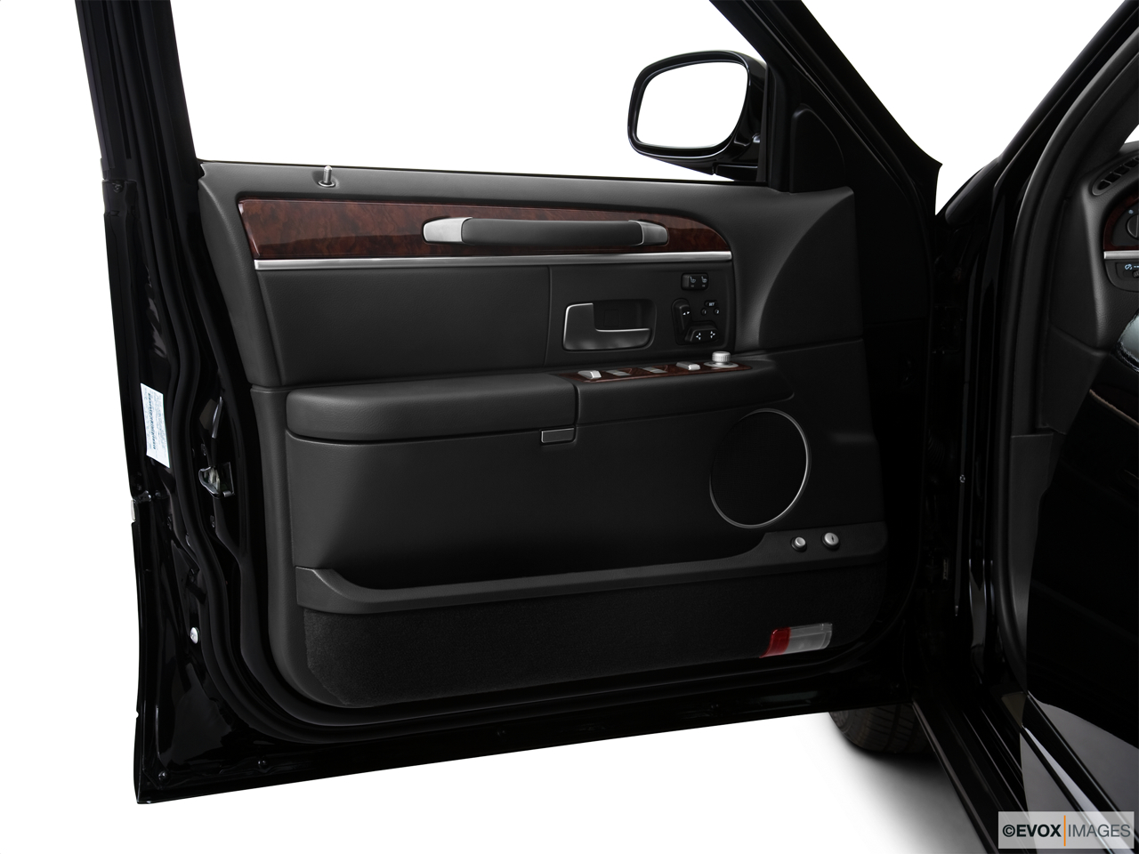 2010 Lincoln Town Car Signature L Inside of driver's side open door, window open.