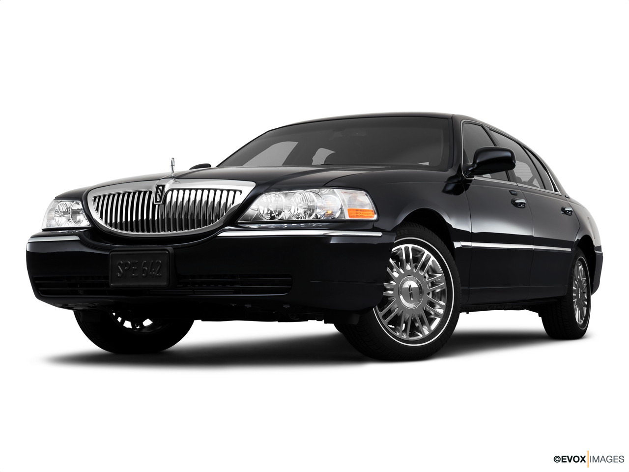 2010 Lincoln Town Car Signature L Front angle view, low wide perspective.