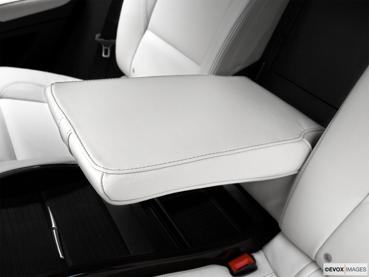 2010 BMW X6 Hybrid Base Rear center console with closed lid from driver's side looking down.