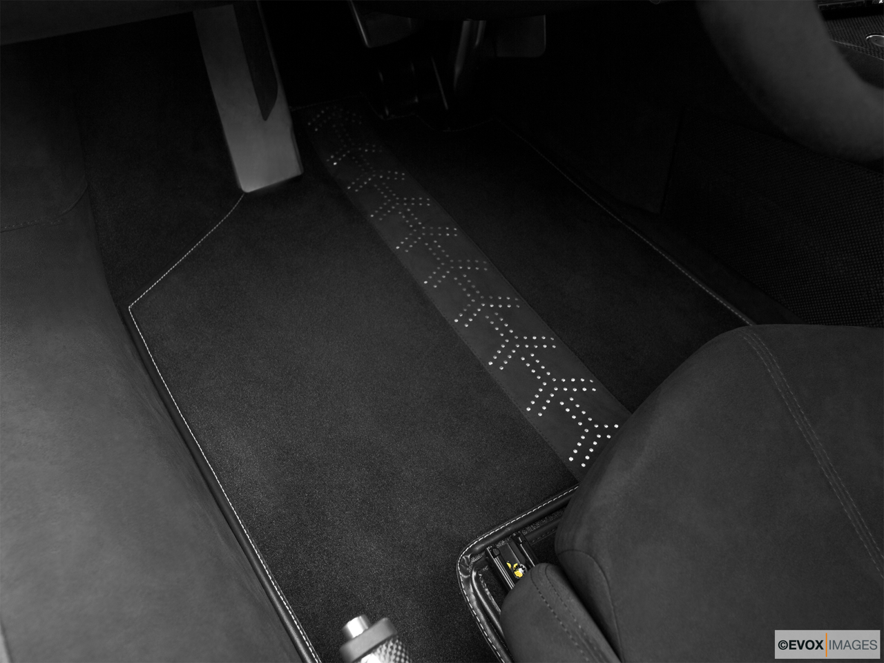 2010 Lamborghini Murcielago LP 640 Super Veloce Driver's floor mat and pedals. Mid-seat level from outside looking in.