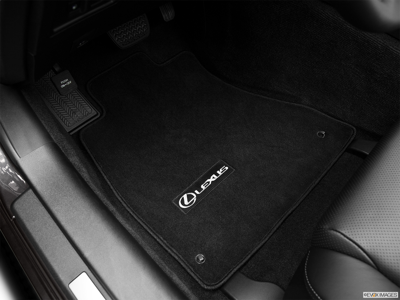 2011 Lexus IS 250C IS250C Driver's floor mat and pedals. Mid-seat level from outside looking in.