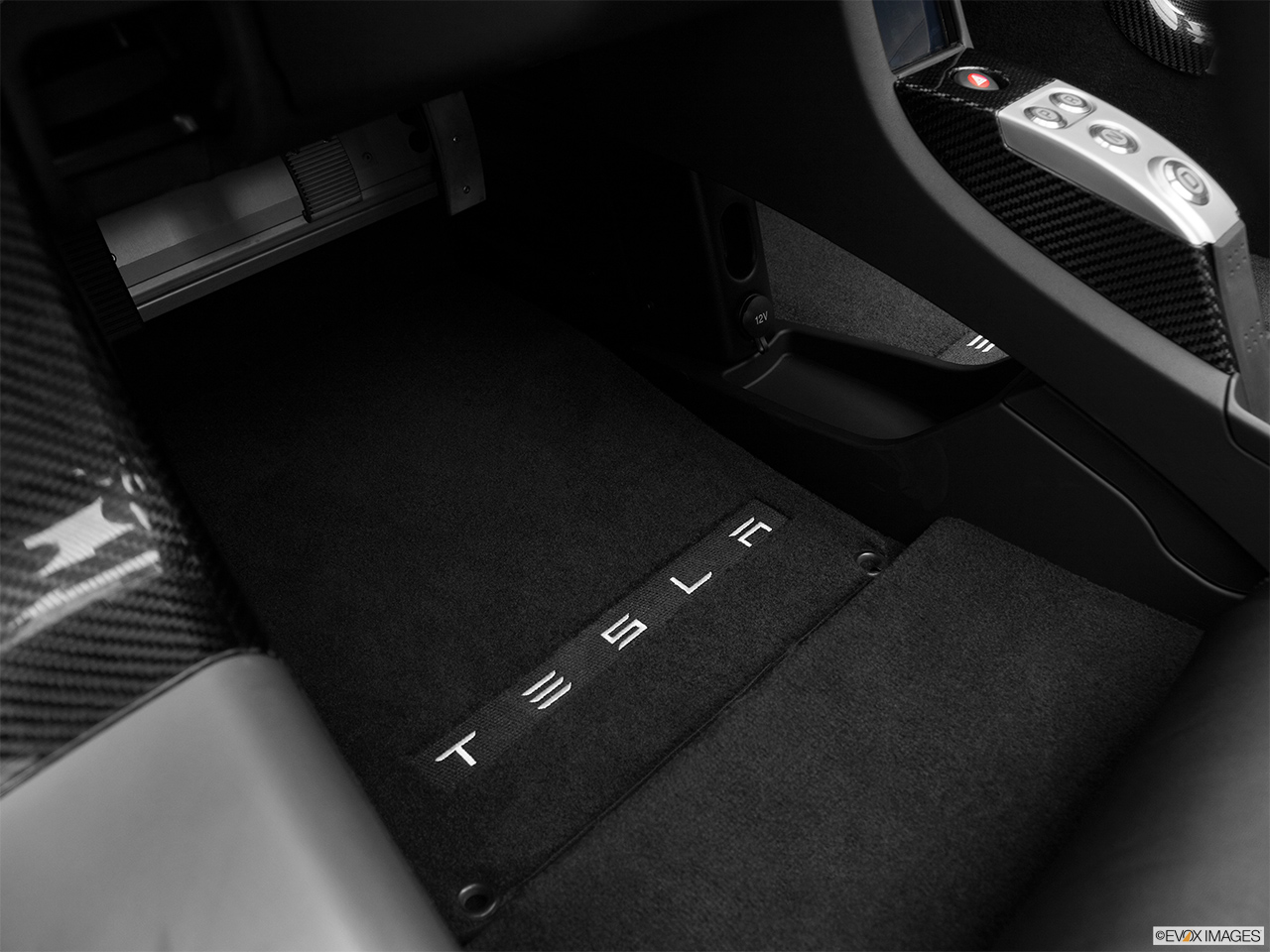 2010 Tesla Roadster sport Driver's floor mat and pedals. Mid-seat level from outside looking in.
