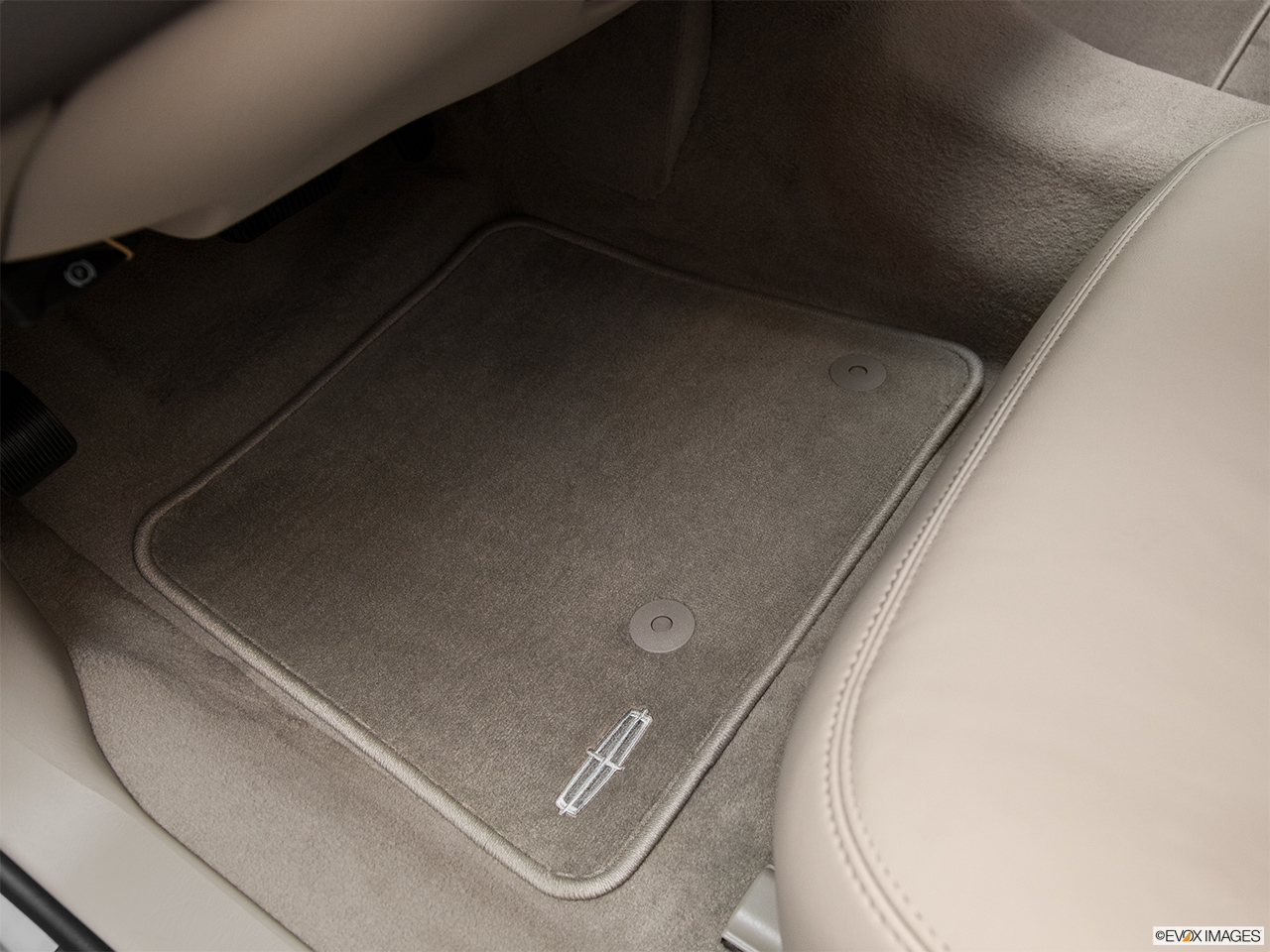 2011 Lincoln Town Car Signature Limited Driver's floor mat and pedals. Mid-seat level from outside looking in.