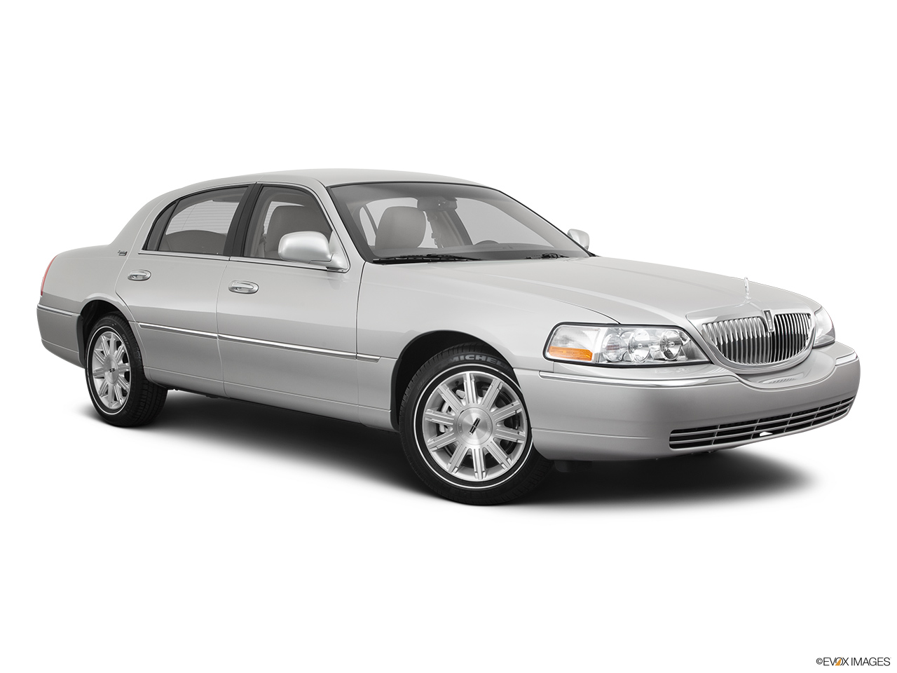 2011 Lincoln Town Car Signature Limited Front passenger 3/4 w/ wheels turned.
