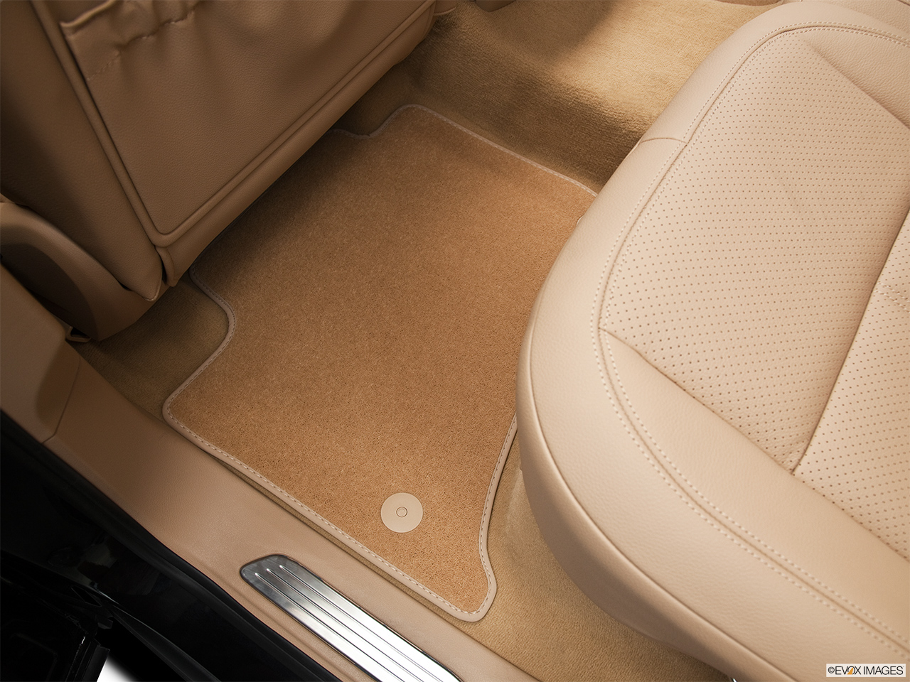 2011 Porsche Cayenne S Hybrid Base Rear driver's side floor mat. Mid-seat level from outside looking in.