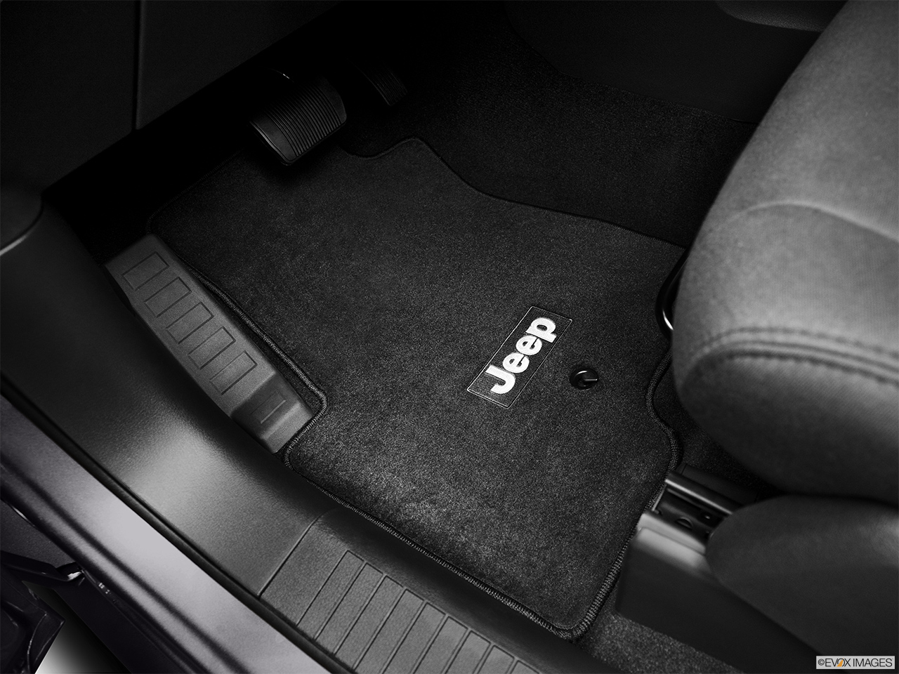 2012 Jeep Patriot Sport Driver's floor mat and pedals. Mid-seat level from outside looking in.