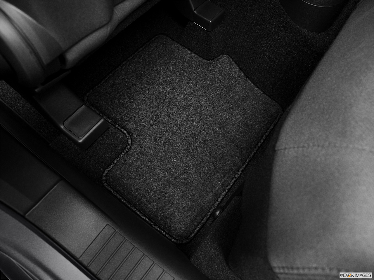 2012 Jeep Patriot Sport Rear driver's side floor mat. Mid-seat level from outside looking in.