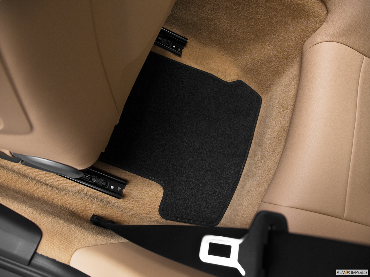 2012 Porsche 911 (991) Carrera S Rear driver's side floor mat. Mid-seat level from outside looking in.