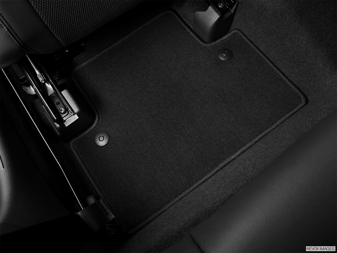 2013 Volvo C30 T5 Premier Plus Rear driver's side floor mat. Mid-seat level from outside looking in.
