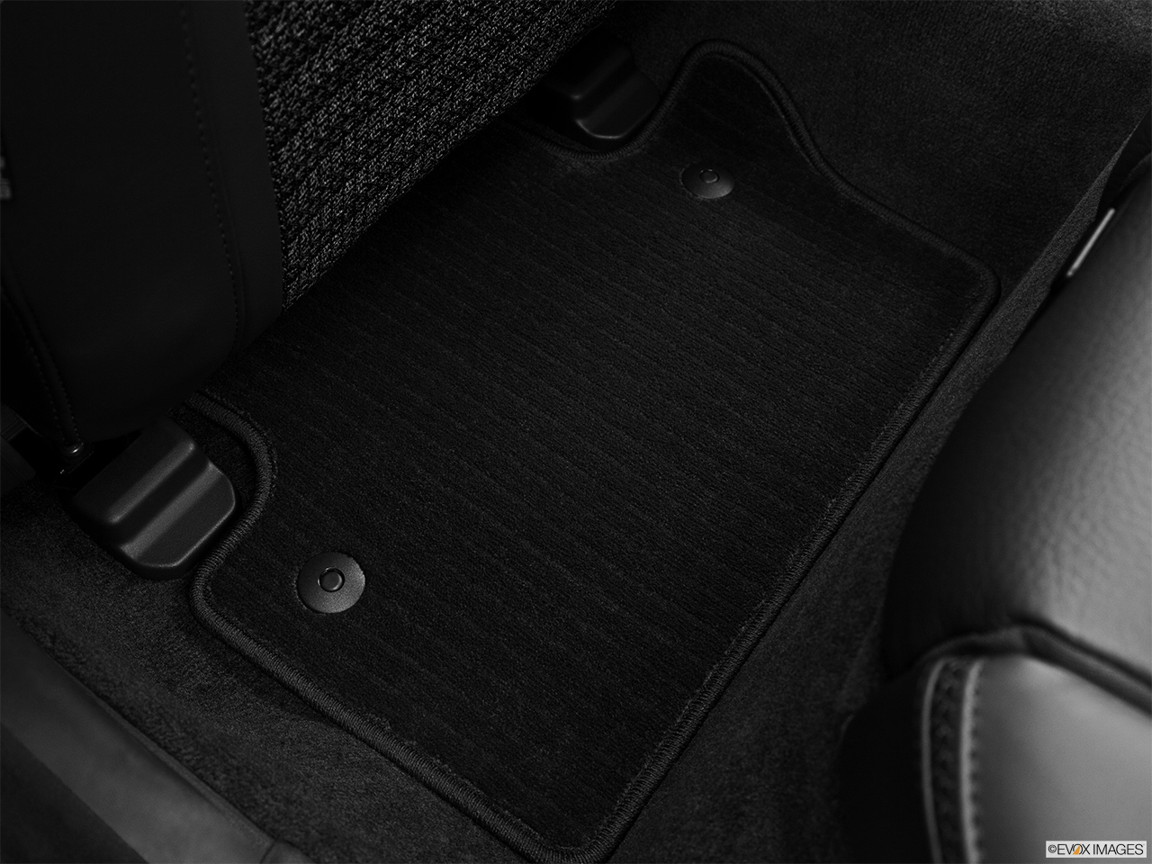2013 Volvo XC70 T6 AWD Platinum Rear driver's side floor mat. Mid-seat level from outside looking in.