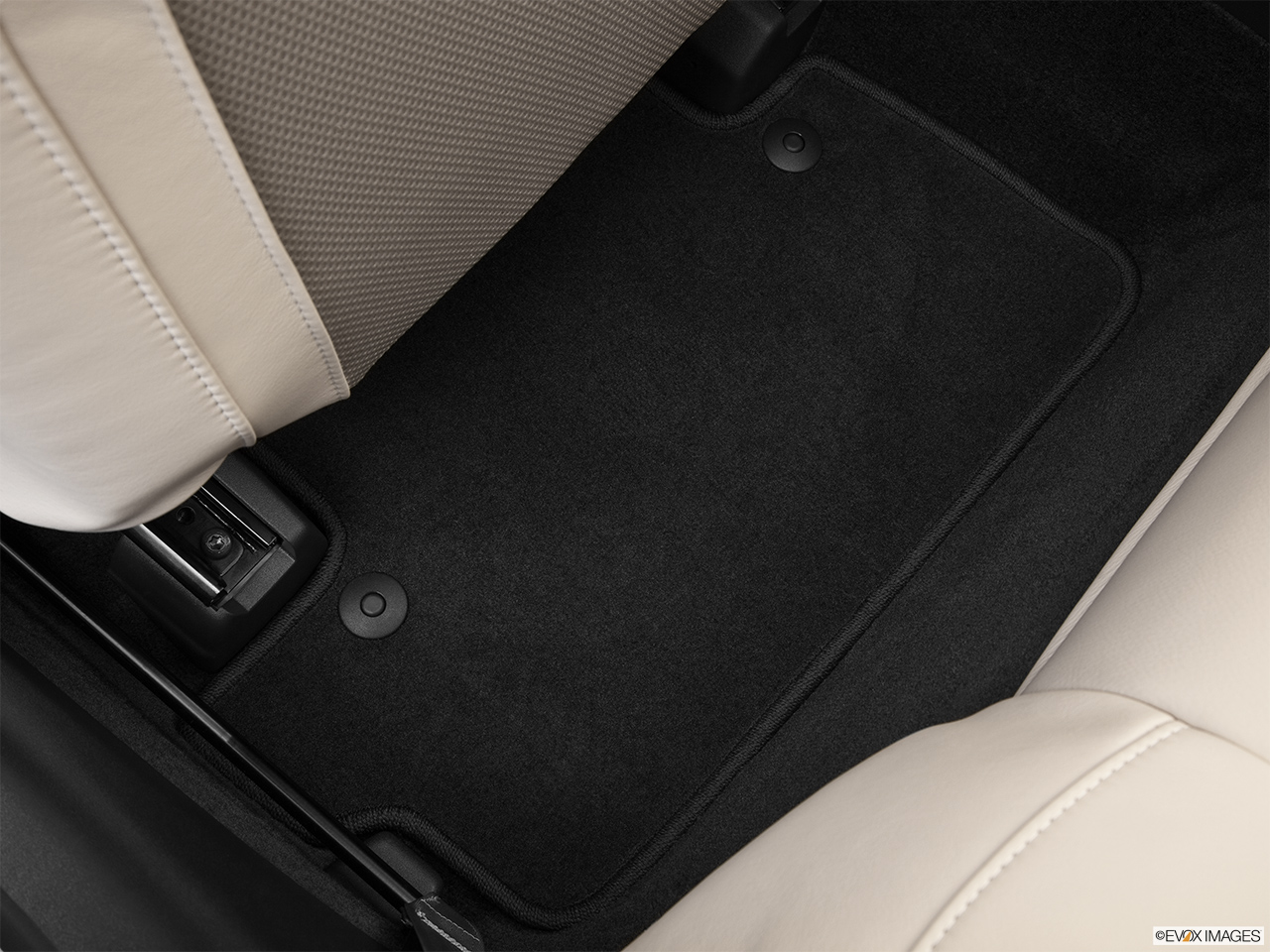 2013 Volvo C70 T5 Platinum Rear driver's side floor mat. Mid-seat level from outside looking in.