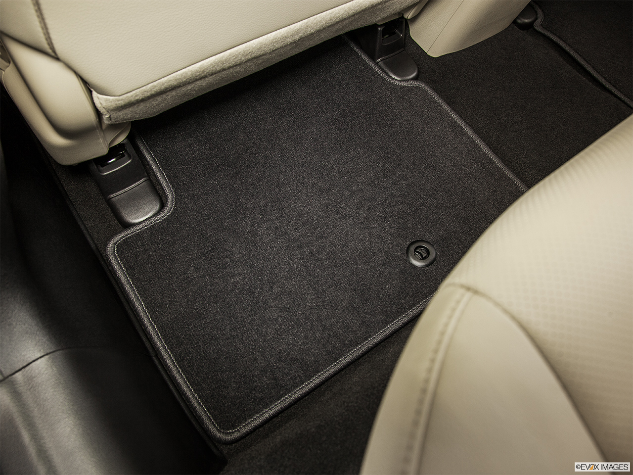 2014 Acura ILX Hybrid Base Rear driver's side floor mat. Mid-seat level from outside looking in.