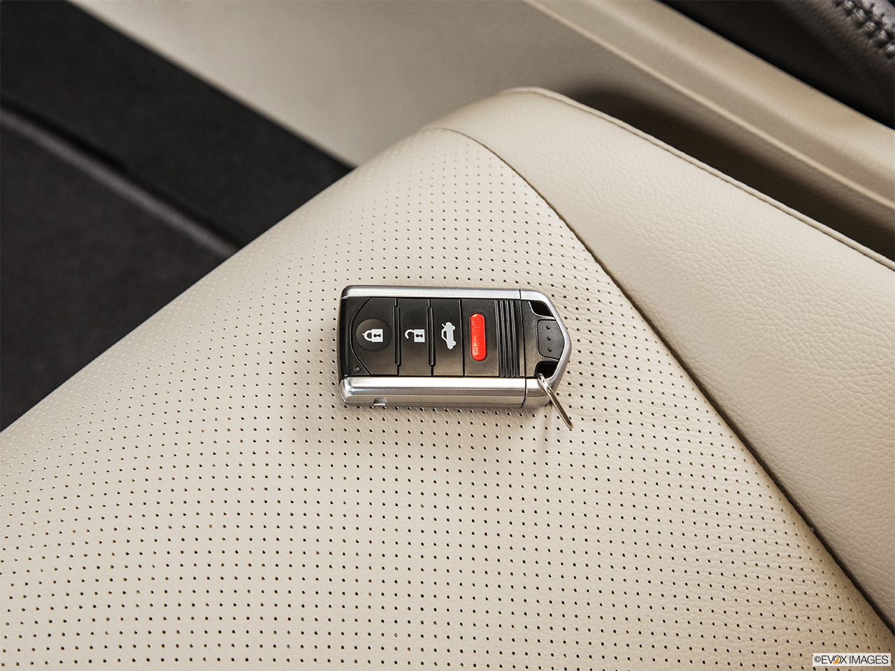 2014 Acura ILX Hybrid Base Key fob on driver's seat.