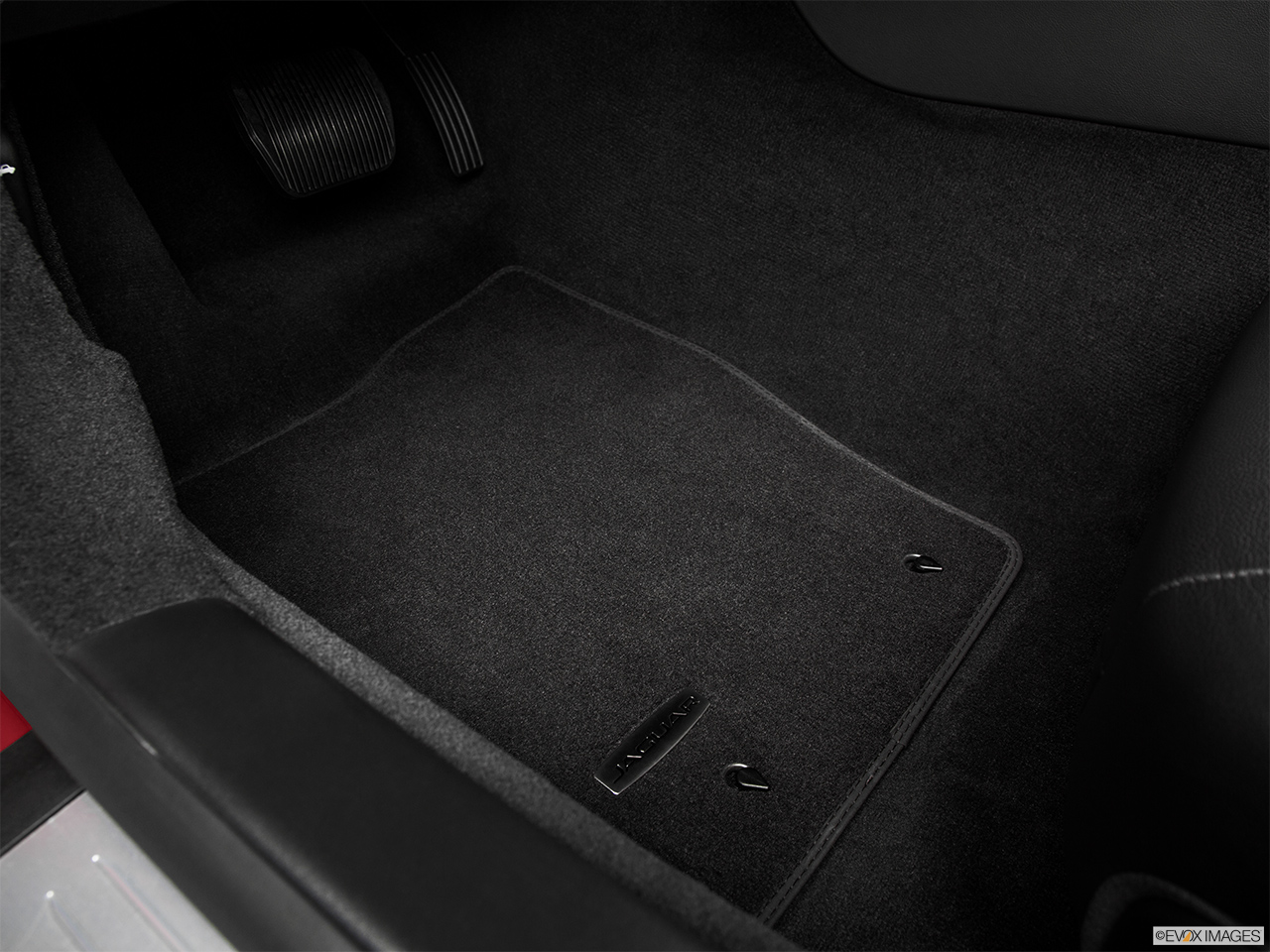 2015 Jaguar F-Type Coupe Base Driver's floor mat and pedals. Mid-seat level from outside looking in.