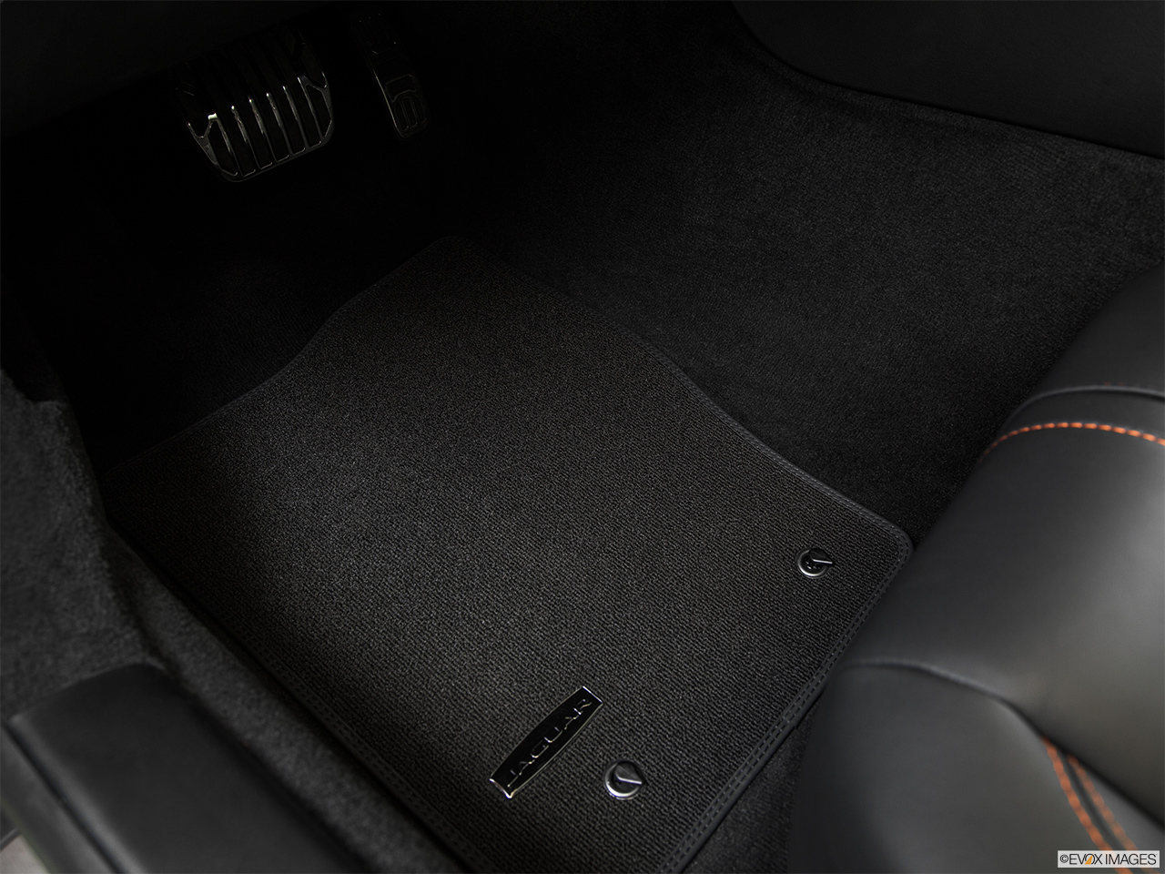 2015 Jaguar F-Type Convertible V8 S Driver's floor mat and pedals. Mid-seat level from outside looking in.