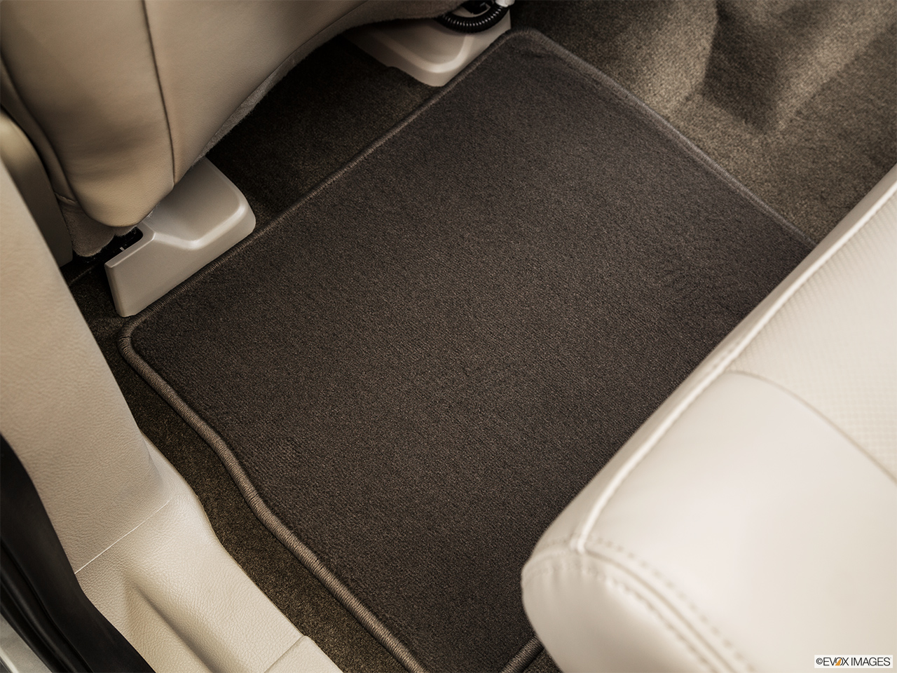 2015 Lincoln Navigator Base Rear driver's side floor mat. Mid-seat level from outside looking in.